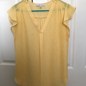 Yellow and white flowy top. Very cute!
